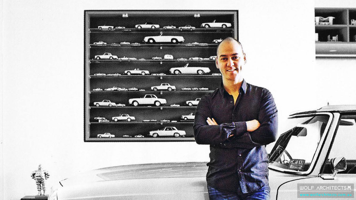 Taras and his car in his office