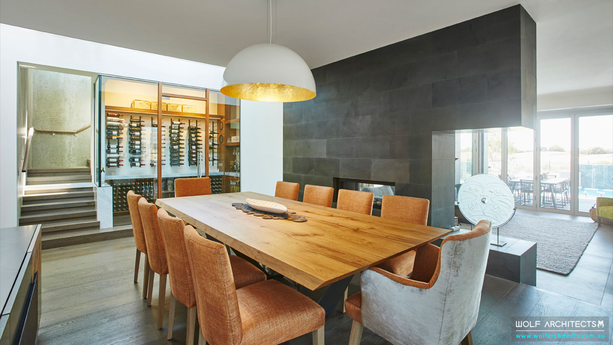 Flow of space from dining to modern Vintage wine cellar by Wolf Architects