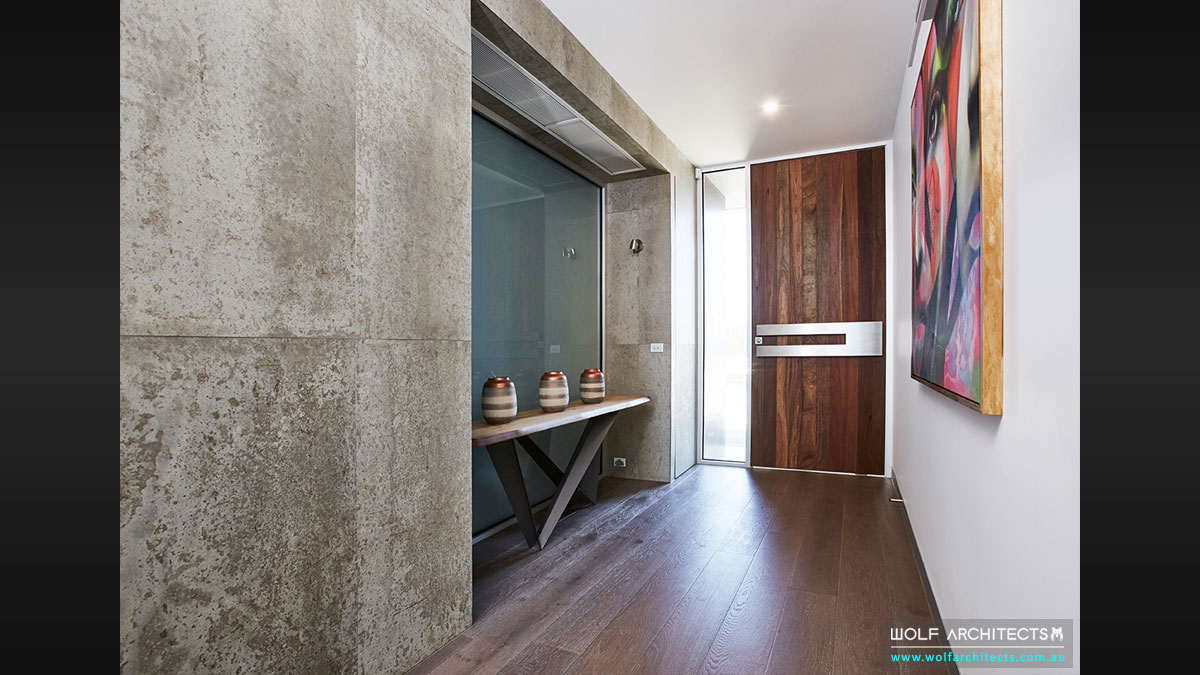 Modern Beach house entry designed for Art works and painting by Wolf Architects