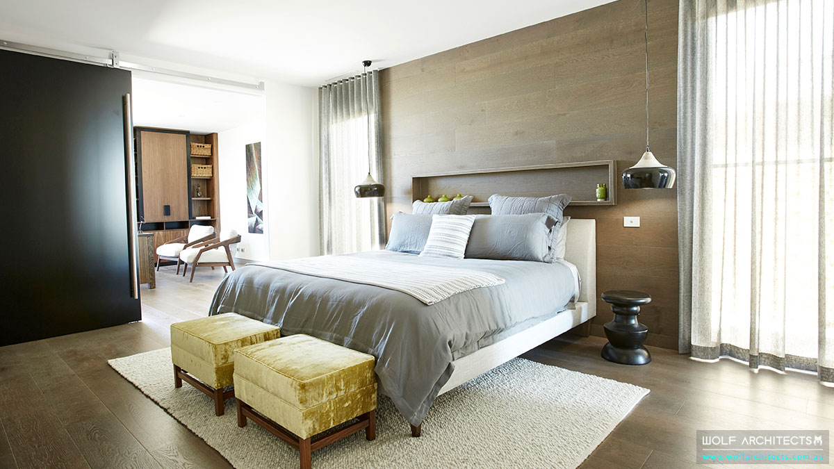 Modern contemporary master bedroom by Wolf Architects