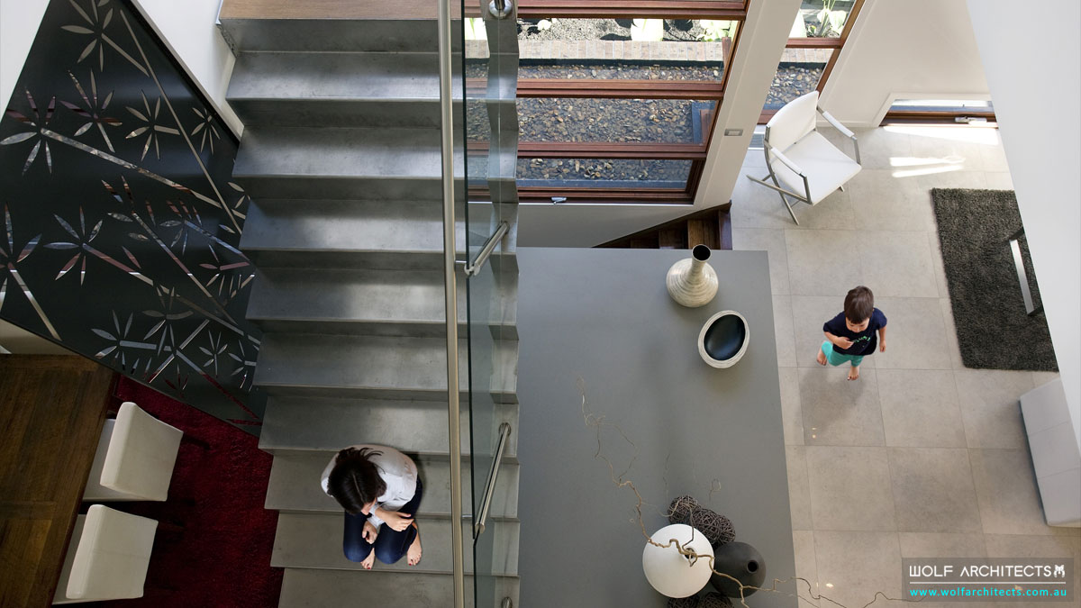 Open void with modern steel stairs by Wolf-Architects