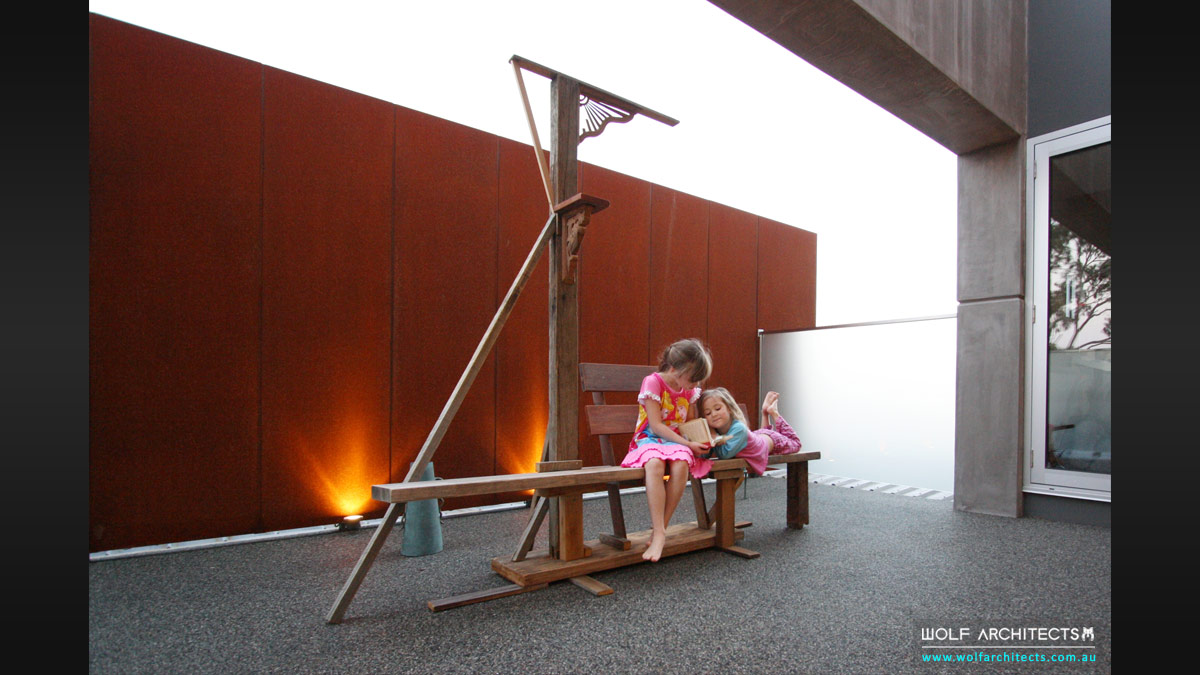 Private courtyard with unique furniture art piece