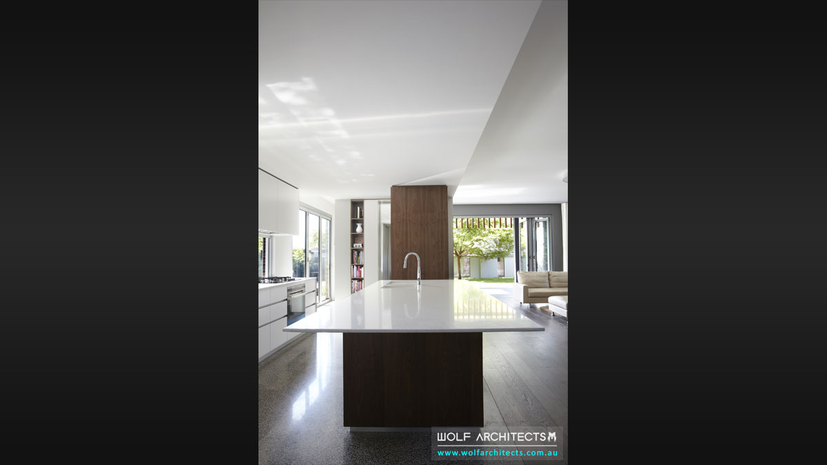 Wolf Architects modern kitchen with unique bench top shark nose edge