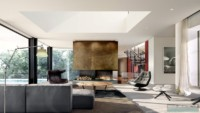 two rock mansion family living room by Wolf-Architects