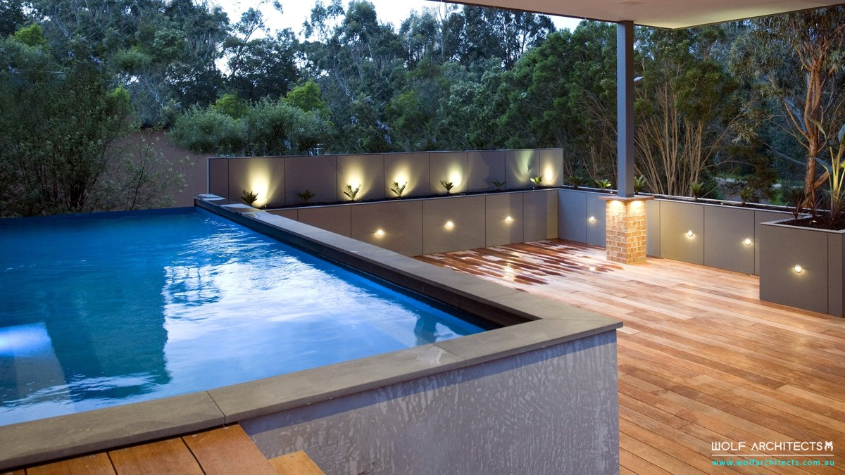 three dimension house outdoor room with pool by Wolf Architects