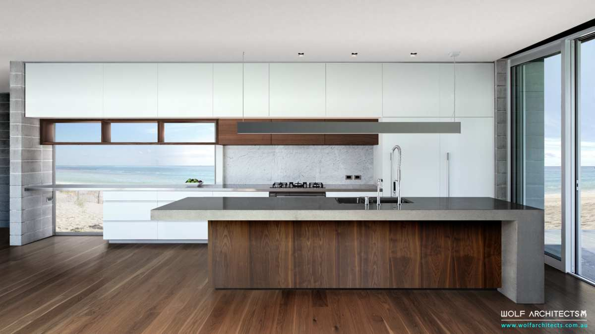 Contemporary Beach House Modern walnut kitchen by Wolf Architects
