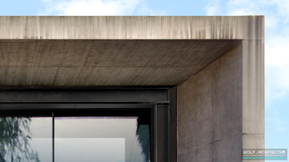 Modern bay view house concrete eave detail by Wolf Architects