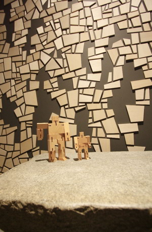 Wall art and two young Cube Robots