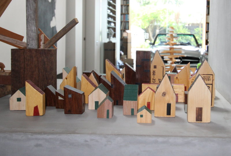 Tiny wooden Village with car in background