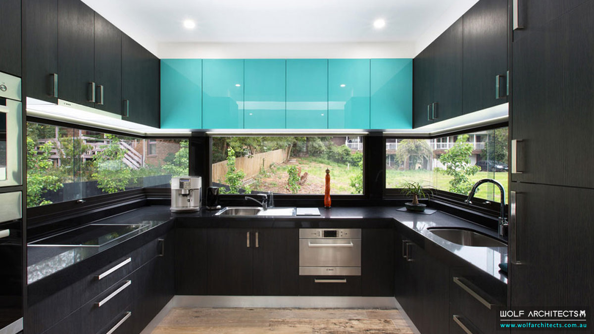 Studio house kitchen with black bench tops and dark cabinets