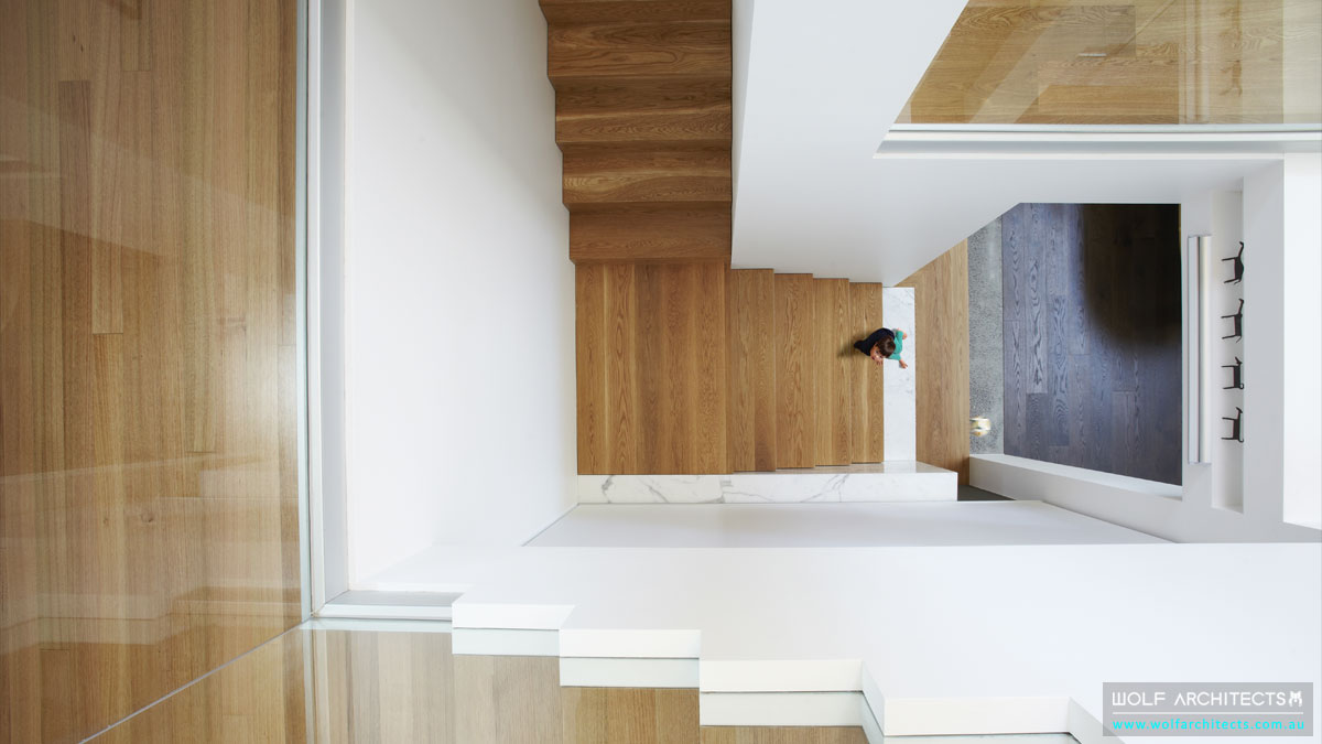 Contemporary modern stair void spaces by Wolf Architects