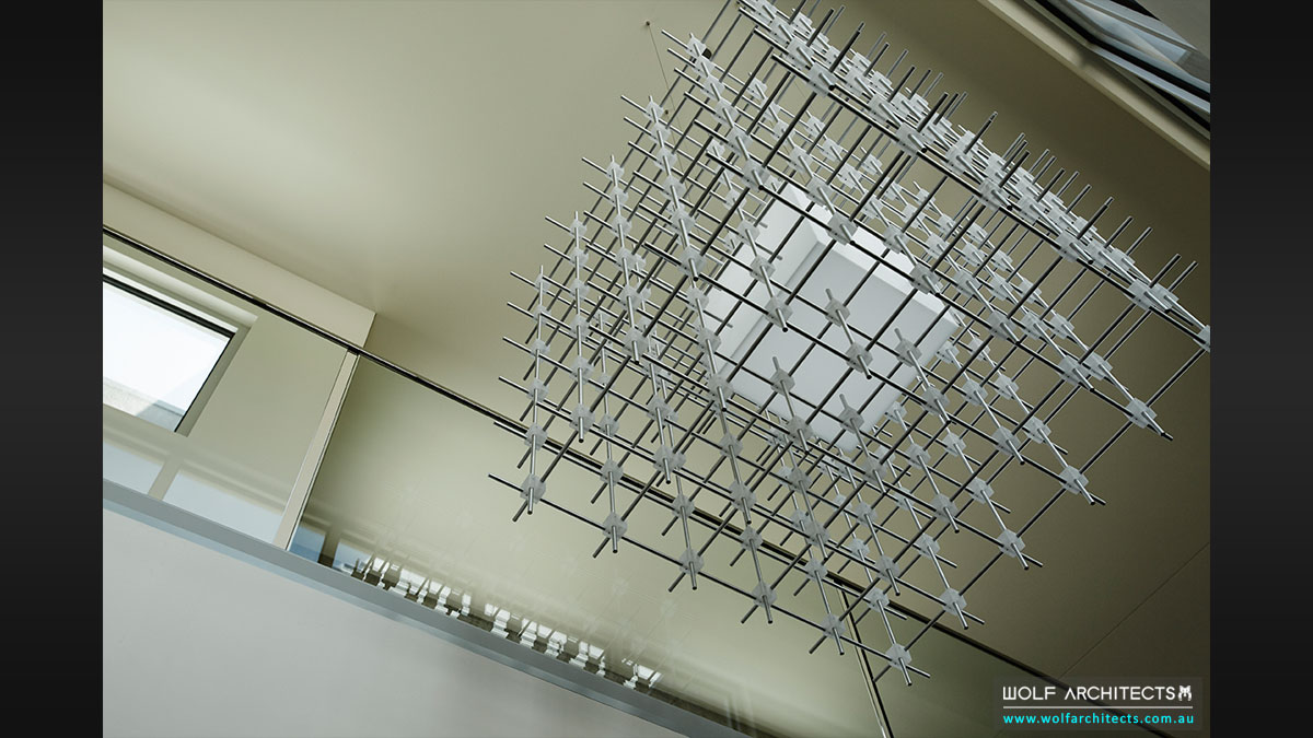 Custom designed matrix cube light fitting in Modern house designed by Wolf Architects