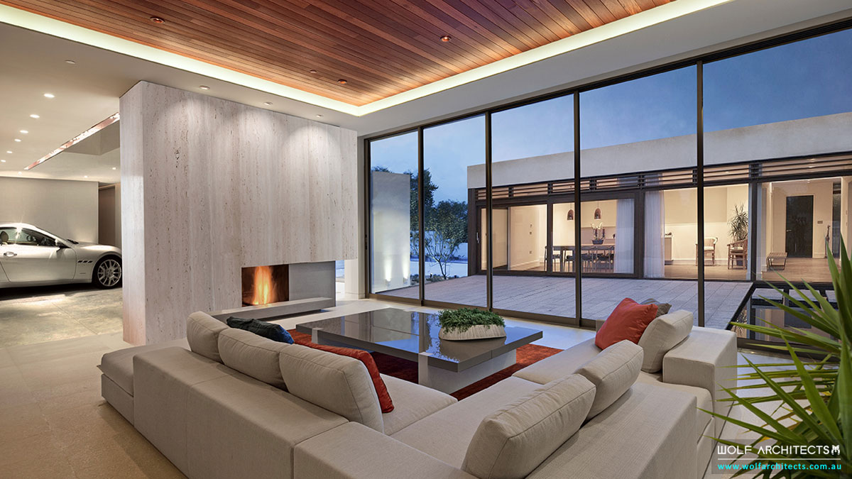 Modern living room with car in the house by Wolf Architects