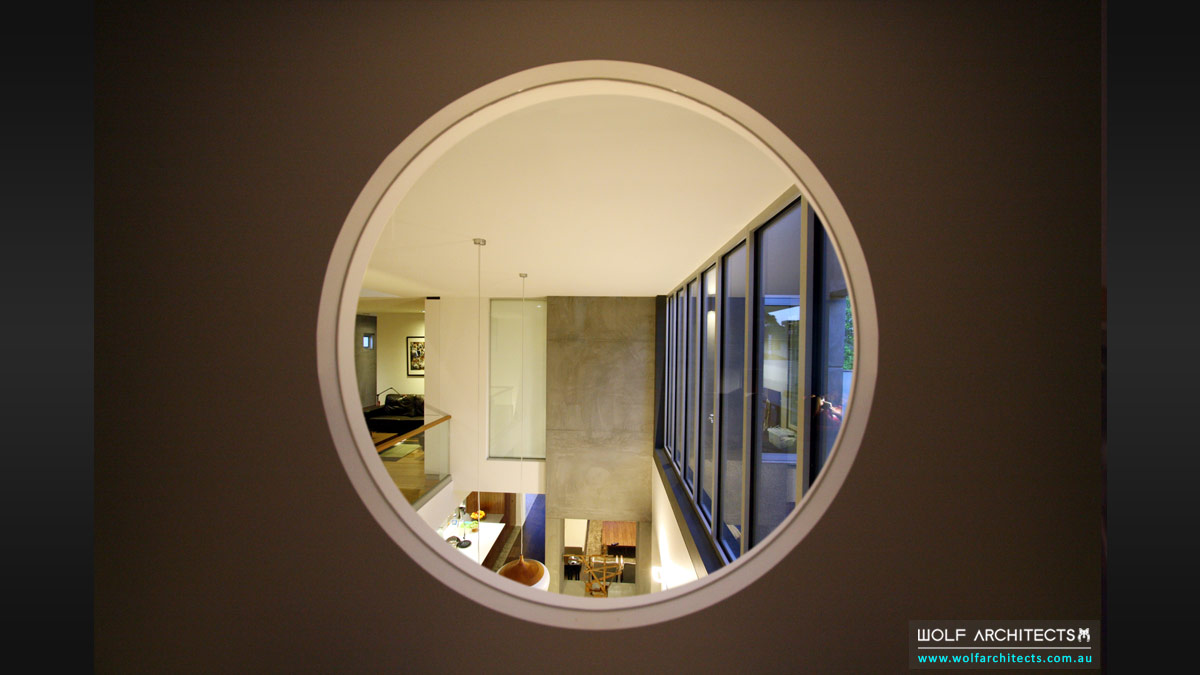 Round circular internal windows framing spaces by Wolf Architects