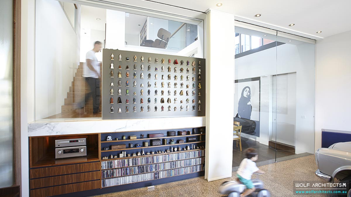 Star Wars feature wall with vintage figures by Wolf Architects