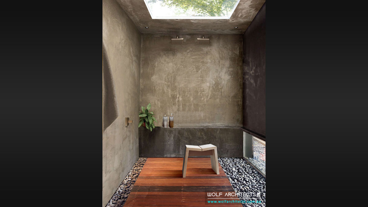 The Spanish Villa Bathroom With Cement Rendered Walls and skylight