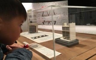 Child looking at model building