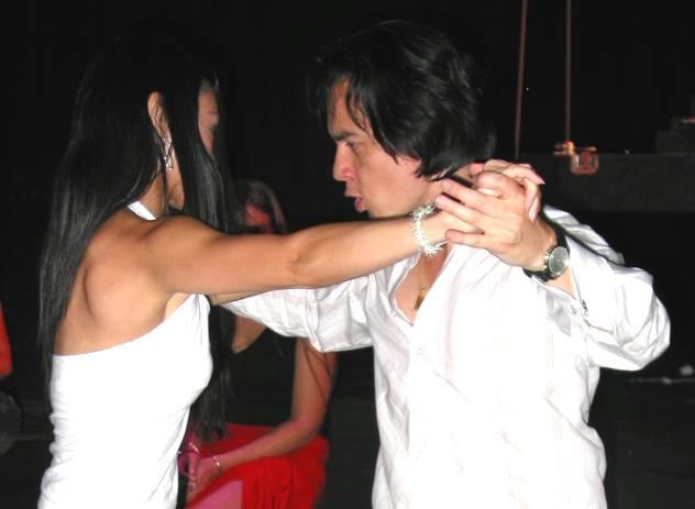 Taras and student dancing