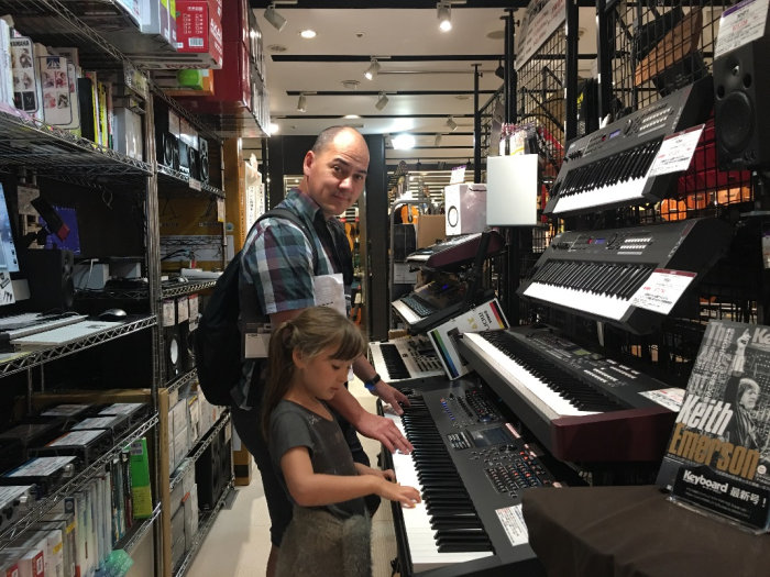 Taras testing synthesisers at the Yamaha Ginza Flagship Store in Japan