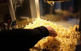 Taras Wolf scooping popcorn