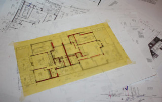 Variations on house plans with yellow trace over printed plans