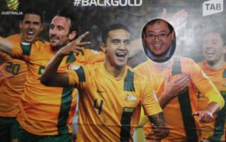 Bin posing in cutout of Socceroos