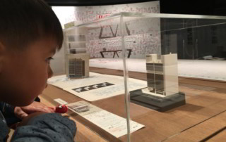 Young boy looking at architecture model