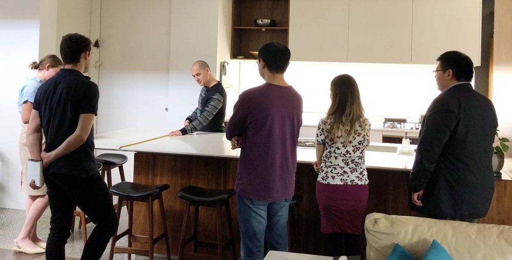 Staff at WOLF getting a Kitchen tutorial