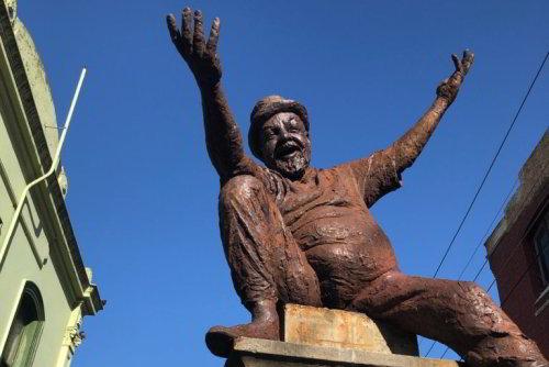 Bronze statue Mr Poetry Adrian Rawlins